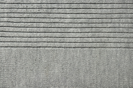 texture of gray knitted fabric, close-up, top view Imagens