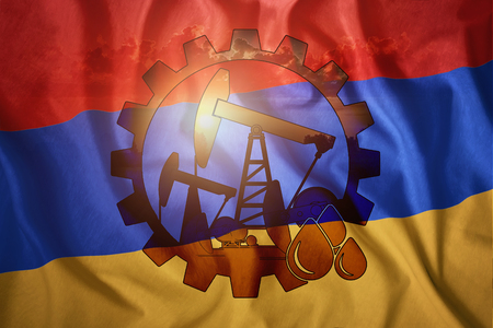 Oil rig against the background of the flag of Armenia. Mixed environment. The concept of oil production, minerals, development of new deposits, well. Stockfoto - 122336976