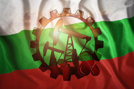 Oil rig on the background of the flag of Bulgaria. Mixed environment. The concept of oil production, minerals, development of new deposits, well.