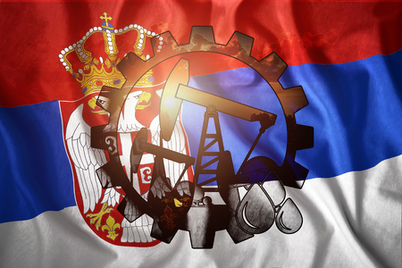 Oil rig on the background of the flag of Serbia. Mixed environment. The concept of oil production, minerals, development of new deposits, well.