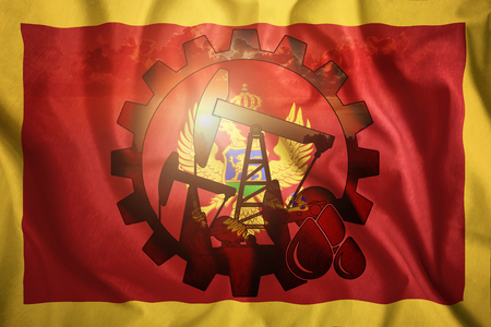 Oil rig on the background of the flag of Montenegro. Mixed environment. The concept of oil production, minerals, development of new deposits, well.