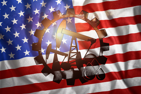 Oil rig on the background of the American flag. Mixed environment. The concept of oil production, minerals, development of new deposits, well. Stockfoto