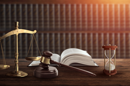 Judges gavel and a book on a wooden table. Concept of law, justice, punishment, judge, corrupt court. copy space Stockfoto