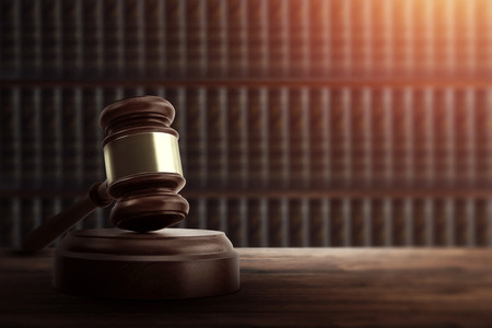 Judges gavel and on a wooden table. Concept of law, justice, punishment, judge, corrupt court. copy space Imagens
