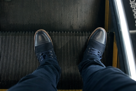foot on escalator for background texture