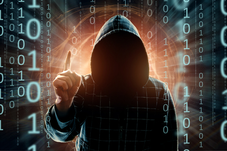 A young hacker in the hood shows a thumbs-up, ATTENTION, a hacker attack, a silhouette of a man, mixed with media. The concept of a sudden attack, cryptography, data security, alertness.