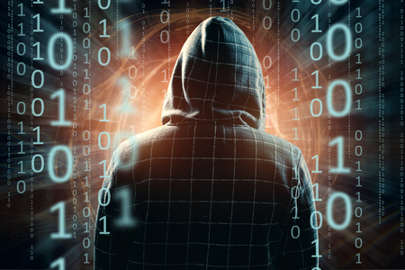 Hacker in the hood, hacker attack, silhouette of the man, mixed media. The concept of a sudden attack, cryptography, data security. Stock Photo