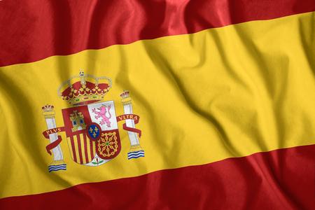 The Spain flag flies in the wind. Colorful national flag of the Spain. Patriotism, patriotic symbol.