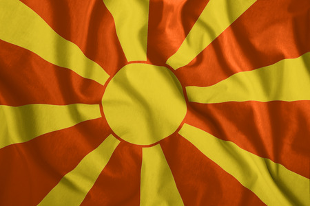 The Macedonia flag flies in the wind. Colorful national flag of the Macedonia. Patriotism, patriotic symbol. Stock Photo