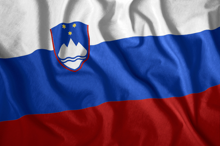 The Slovenia flag flies in the wind. Colorful national flag of the Slovenia. Patriotism, patriotic symbol.