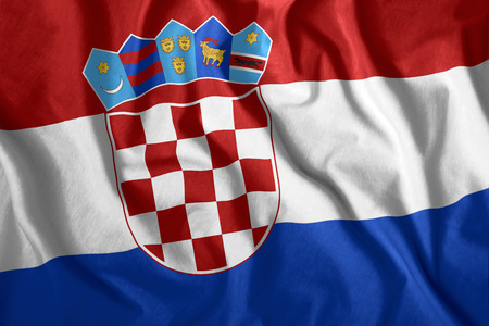 The Croatian flag is flying in the wind. Colorful national flag of Croatia. Patriotism, patriotic symbol. Stock Photo