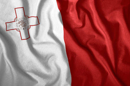 The Malta flag flies in the wind. Colorful national flag of the Malta. Patriotism, patriotic symbol.