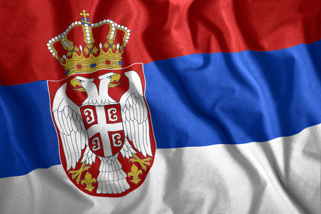 The Serbia flag flies in the wind. Colorful national flag of the Serbia. Patriotism, patriotic symbol. Stock Photo