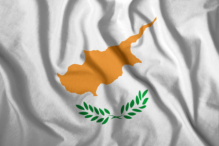 The Cyprus flag flies in the wind. Colorful national flag of the Cyprus. Patriotism, patriotic symbol.