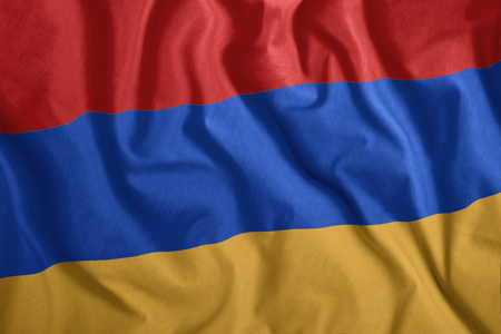 The Armenian flag flutters in the wind. Colorful, national flag of Armenia. Patriotism, a patriotic symbol.