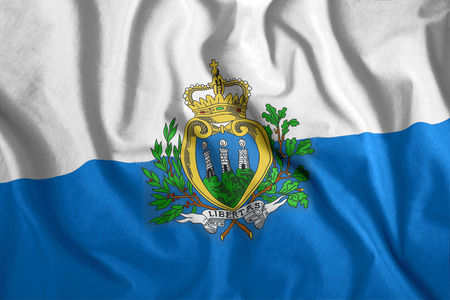 The Marino flag flies in the wind. Colorful national flag of the Marino. Patriotism, patriotic symbol.