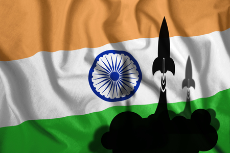 Floating rockets against the background of the flag of India fluttering in the wind. Symbol, war, conflict.