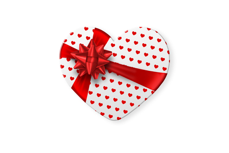 White gift box in the shape of a heart with a festive white bow isolated on white background. Romance, Valentine's Day, love.