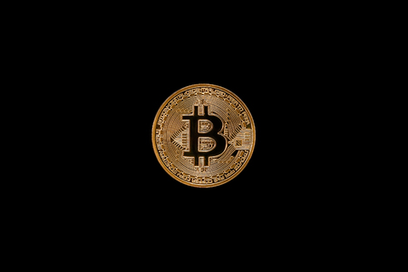Coin bitcoin isolate on a dark background