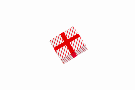 White-Red New Years gift in stripes, isolated on white background. Zdjęcie Seryjne