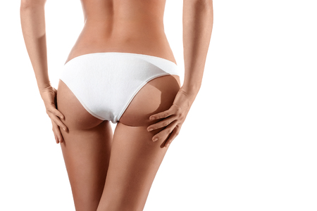 Perfect female body, buttocks close-up in white underwear, isolated on white background. The concept of beauty, plastic surgery. 版權商用圖片