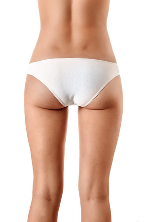 Perfect female body, buttocks close-up in white underwear, isolated on white background. The concept of beauty, plastic surgery. 免版税图像