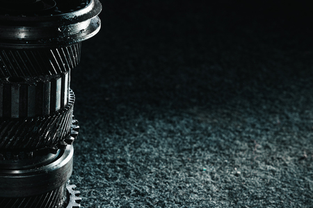 Gears and bearings on a dark background. Automotive concept. Copy space