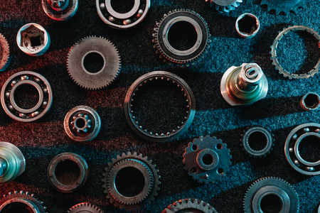 Gears and bearings on a dark background. Top view, flat design. Automotive concept.