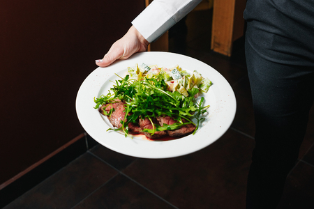 steak with blood of arugula and salad