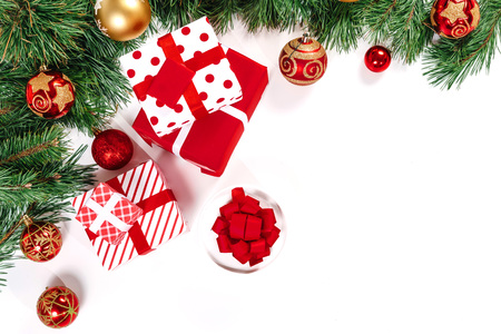 Branches of spruce with gold and red balls and gifts, isolated on white background. Isolate.