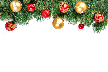 Christmas frame - tree branches with gold and red balls isolated on white background. Isolate. Reklamní fotografie