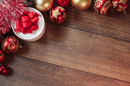 Christmas ornaments and gifts on a wooden table. Holidays christmas background. Copy space for text or design. View from above.