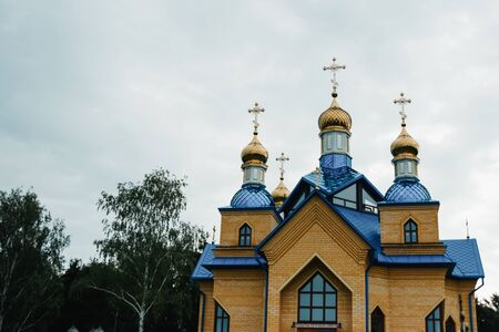 Eastern orthodox crosses on gold domes (cupolas) againts blue sky with clouds Stok Fotoğraf