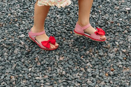 Two girls train in run, feet of running children close-up Stock Photo