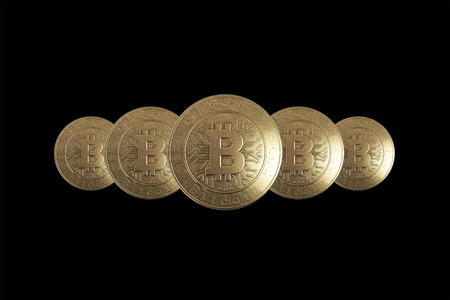 Gold coin Bitcoin on a black background. The concept of crypto currency. Blockchain technology. Imagens - 122720583