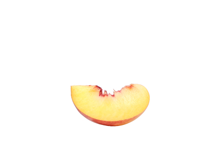 A peach slice isolated on a white background. 写真素材