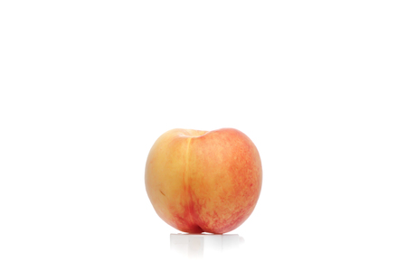 An Apricot isolated on a white background