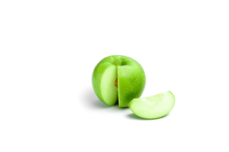 Ripe green apple with leaf and slice isolated on a white background with clipping path Stock Photo