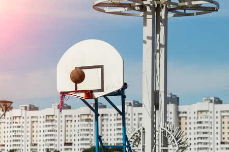 street basketball court ring board against the sky