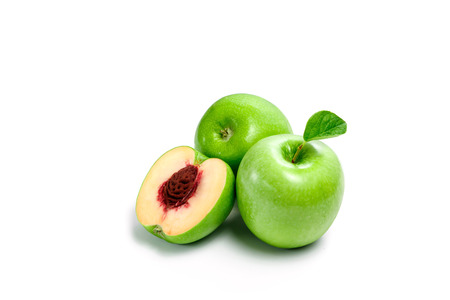 Green apple peach on white background, isolate. A product of genetic engineering, genetically modified fruit. Image computer collage. The concept of GMF, not that it seems, a surprise, a deception, a