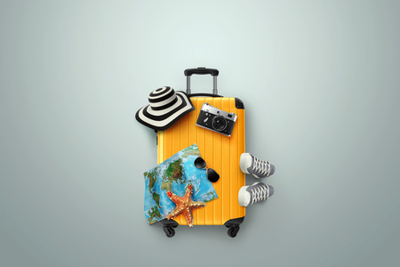 Creative background, yellow suitcase, sneakers, map on a gray background. Concept of travel, tourism, vacation, vacation, dream. Copy space. 3D illustration, 3D rendering