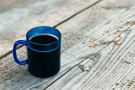 Blue mug on a wooden table top