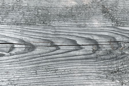 Natural knotted gray weathered wood plank texture background.