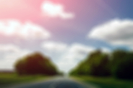 Abstract blurred background, blue sky and road leaving in the distance Stock fotó