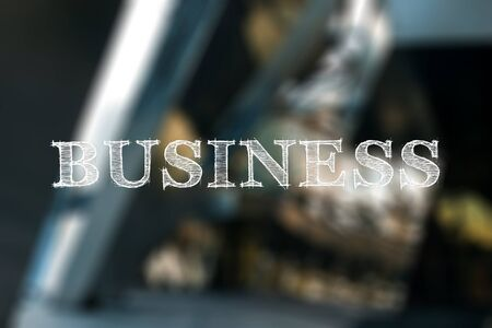 Concept of business, word business on a blurry building background Banco de Imagens