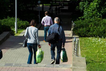 A pair of elderly people travels