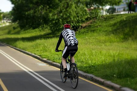 A cyclist at top speed on the triathlon race. Banco de Imagens