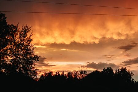 Bloody clouds. Red clouds sunset. Stock Photo