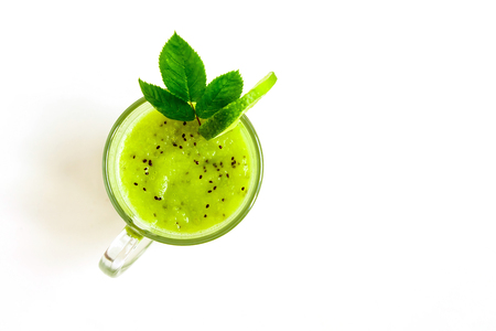 Green healthy cocktail of kiwi, green apple, lime and mint isolated on white background top view