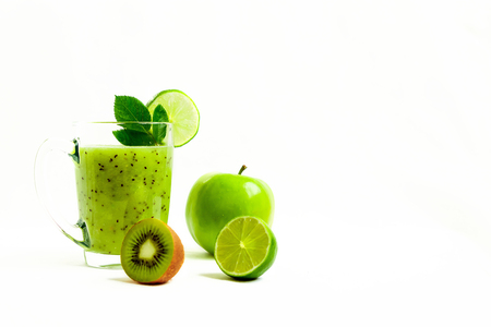 Green healthy cocktail of kiwi, green apple, lime and mint isolated on white background view of a crook Фото со стока